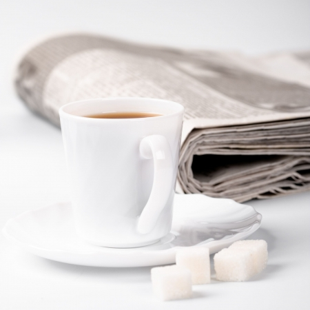cup of coffee, sugar and stack of newspapers closeup Stock Photo - 7272345