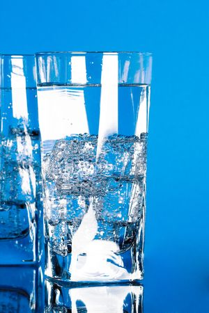 glasses with cold water on blue background Stock Photo - 7272363