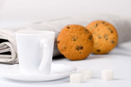 cup of coffee, sugar, muffins and stack of newspapers closeup Stock Photo - 7276889