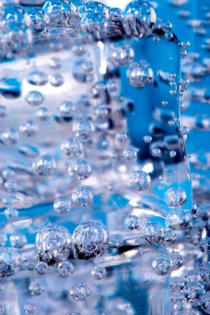 macro image of ice cubes and water bubbles photo