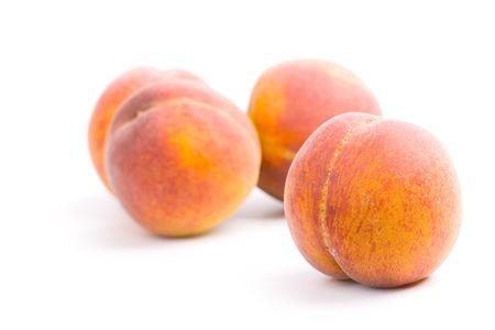 four peaches on white background