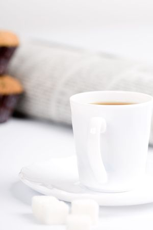 cup of coffee, sugar, muffins and stack of newspapers closeup photo