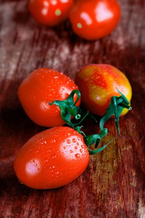 macro images of tomatoes closeup on wooden table photo