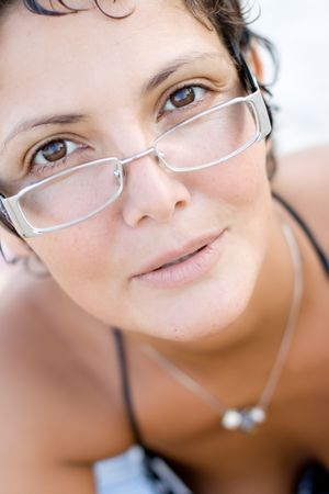 portrait of attractive brunet woman on eyeglasses photo