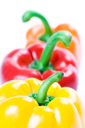 three bell peppers closeup on white background photo