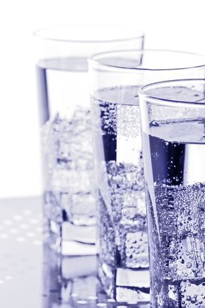 three glasses with cold water closeup on white background photo
