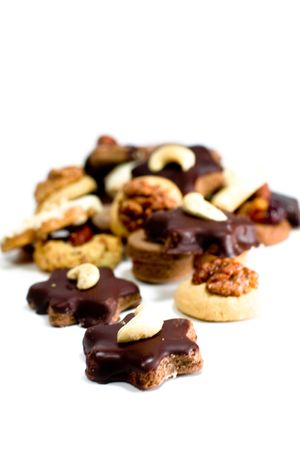cookies with chocolate and nuts closeup on white background photo