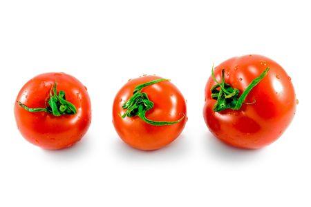 three fresh tomatoes isolated on white background photo
