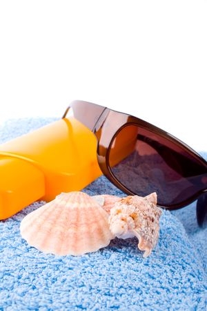 towel, shells, sunglasses and lotion closeup on white background Stock Photo - 7635012
