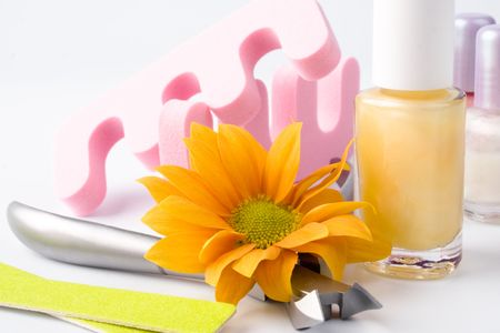 pedicure beauty set and flower closeup photo