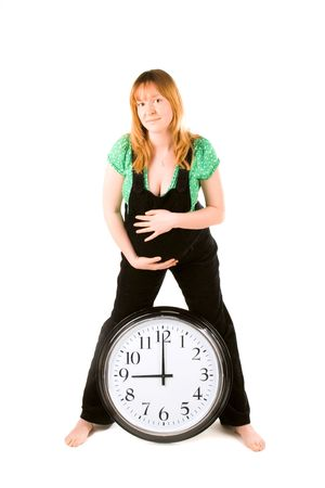 pregnant woman with a clock on white background photo
