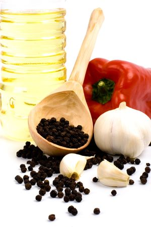 paprika, garlic, black pepper and oil closeup on white background photo