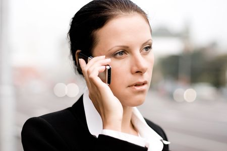 pretty businesswoman talking by mobile phone Stock Photo - 7635058