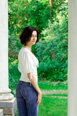 partrait of attractive woman standing near white column Stock Photo - 7635455