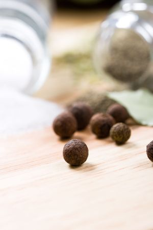 spices: pepper and bay leaves closeup on wooden background  photo