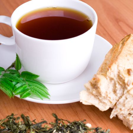 cup of tea with herbs and bread photo