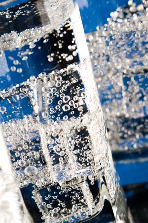 glasses with cold water closeup on blue background photo