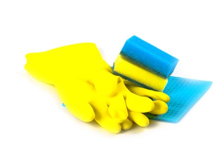 rubber gloves and sponges isolated on white background photo