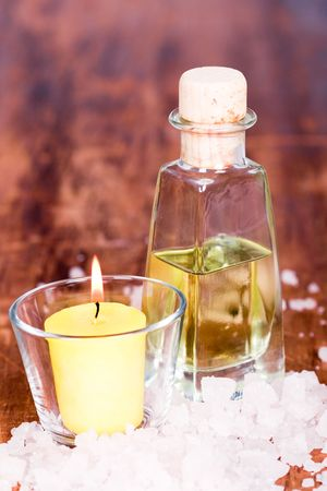 bath and spa items (oil, salt, candle) on wooden table photo