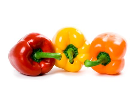 three bell peppers isolated on white background photo