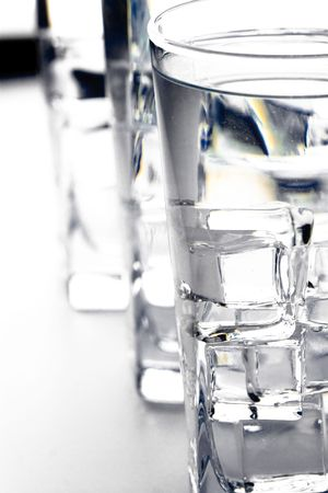 three glasses with water closeup on white background photo