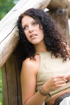 outdoor portrait of attractive brunet woman photo