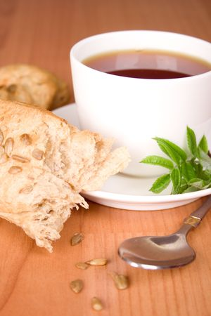 cup of black tea with herbs and bread photo