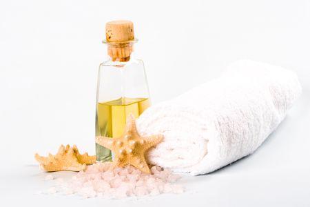 spa products: sea salt, towel, oil and stars photo