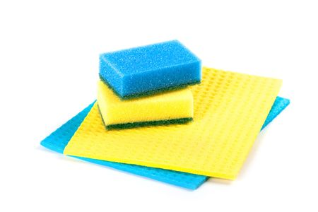 blue and yellow sponges isolated on white background  photo