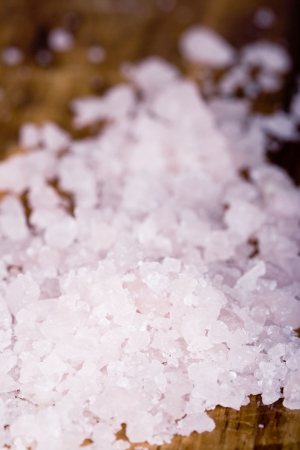 macro image of sea salt crystals  on wooden background photo