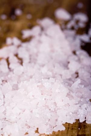 macro image of sea salt crystals  on wooden background photo