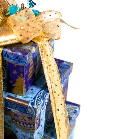 pyramid of blue gift boxes with golden bow closeup on white background photo