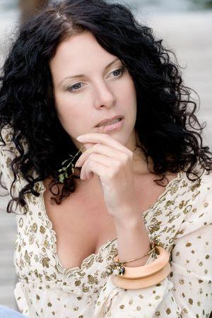 beautiful brunet woman sitting on wooden floor photo