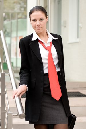 outdoor portrait of businesswoman with portfolio on a stairs Stock Photo - 7716997