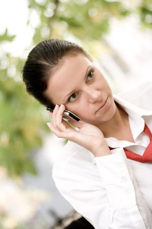 attractive businesswoman talking by mobile phone photo