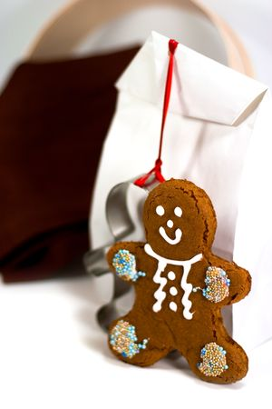 gingerbread man and gift bag closeup on white background photo