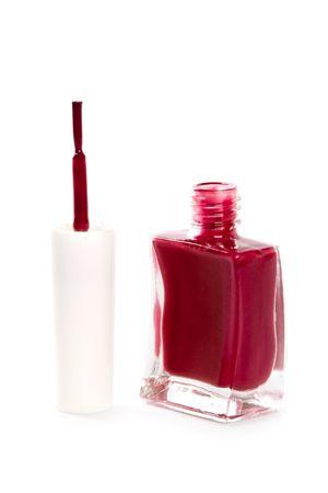 opened nail polish isolated on white background photo
