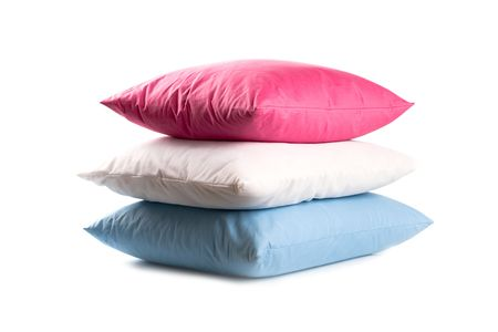 pink, white and blue pillows isolated on white background  photo