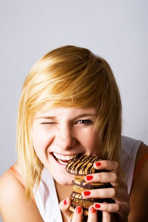 young woman eating chocolate chip cookies Stock Photo - 7981499