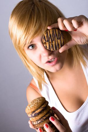 young woman eating chocolate chip cookies Stock Photo - 7981505