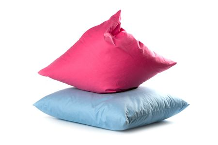 bed spreads: pink and blue pillows isolated on white background  Stock Photo