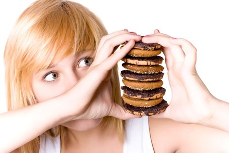 closeup portrait of young woman with chocolate chip cookies Stock Photo