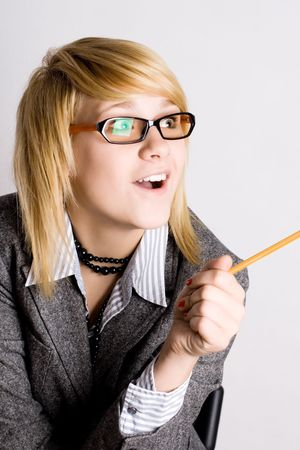 portrait of young businesswoman with pencil photo