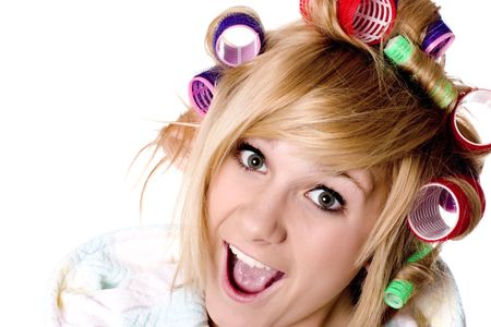 closeup portrait of funny housewife with curlers on white  photo