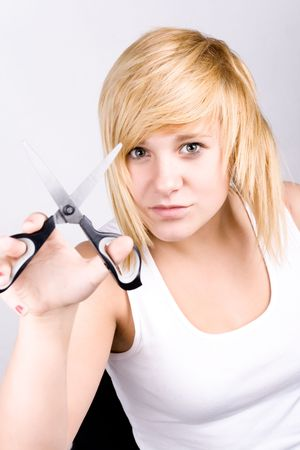 closeup portrait of attractive young woman with scissors Stock Photo - 8033409
