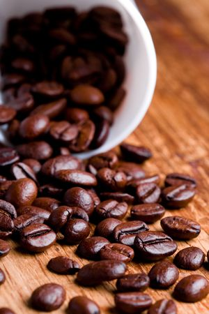 cup with coffee beans on wooden background photo