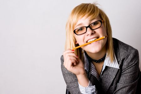 closeup portrait of young businesswoman with pencil  photo