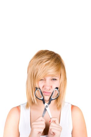 attractive young woman with scissors isolated on white background Stock Photo - 8033455