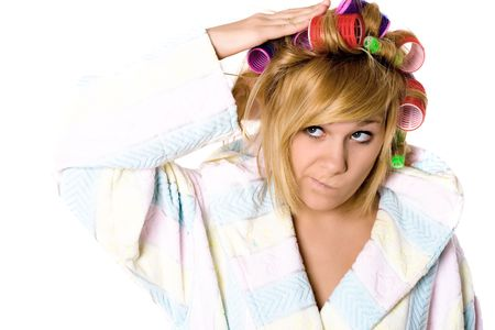 curlers: closeup portrait of funny housewife with curlers on white background