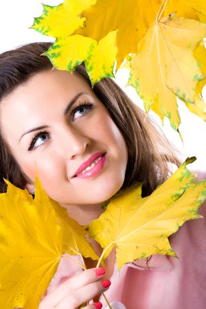 portrait of beautiful young woman with yellow leaves  photo